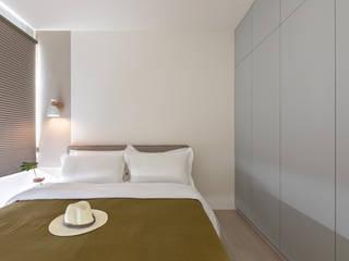 Dormitorios escandinavos de 寓子設計 Escandinavo