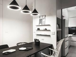 Modern dining room by 文儀室內裝修設計有限公司 Modern