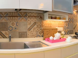 Vanilla color theme with the contrasting yellow highlights Lakkad Works Kitchen