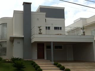 MARIA IGNEZ DELUNO arquitetura Detached home Bricks Grey