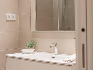 Cambio de uso. Reforma completa vivienda Interiorismo Laura Mas Baños de estilo mediterráneo Cerámico Beige