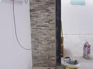 Rivestimento murale effetto roccia EDIL MAVI costruzioni Pareti & Pavimenti in stile moderno Pietra