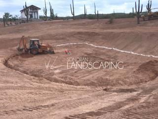 Lago artificial en zona campestre Sonoran Landscaping Jardines rústicos