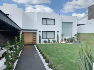 G._ALARQ + TAGA Arquitectos Modern houses