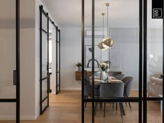 KODO projekty i realizacje wnętrz Salle à manger moderne Gris
