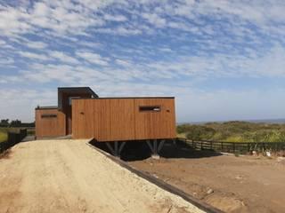 LOTE 14, VISTA LOBOS PICHILEMU KIMCHE ARQUITECTOS Casas de madera Madera Acabado en madera