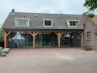 Schmidinger Wintergärten, Fenster & Verglasungen Rustieke serres Aluminium / Zink Grijs