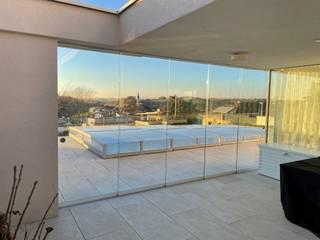 Schmidinger Wintergärten, Fenster & Verglasungen Balcones y terrazas modernos