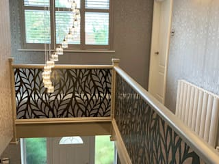 Renovated staircase with laser cut infill - Frond design Staircase Renovation Escalier Métal