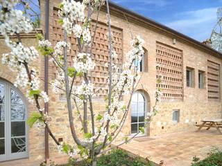Restauro Annesso e nuova costruzione di laghetto artificiale Arch. Alessandra Cipriani Casa di campagna