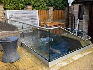 Glass balustrade surrounding a Pond, in Sheffield Origin Architectural Kolam taman Kaca Transparent