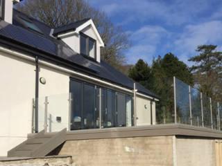Post and Rail Glass Balustrade in Llanelli, Wales Origin Architectural Taman Modern Kaca Transparent