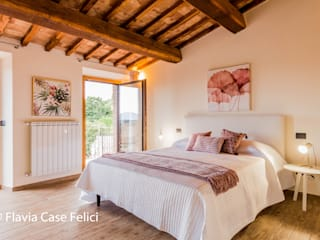 Flavia Case Felici 地中海スタイルの 寝室