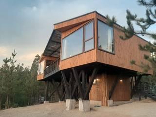 VIVIENDA, LOMA ALTA, PICHILEMU KIMCHE ARQUITECTOS Casas de madera Madera Acabado en madera