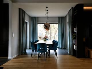 Projekt domu w Józefowie Piotr Stolarek Projektowanie Wnętrz Nowoczesna jadalnia