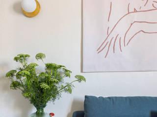 Renovación express para un piso de alquiler de 56 metros a dos pasos del Matadero de Madrid Interiorismo y decoración en Madrid / Kando Estudio Salones de estilo moderno Azul