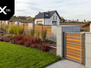 XCEL Fence Jardins de fachadas de casas