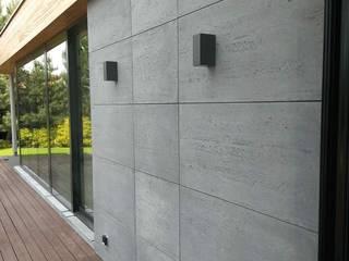 Elewacja budynku - beton architektoniczny Luxum Nowoczesne domy Beton Szary
