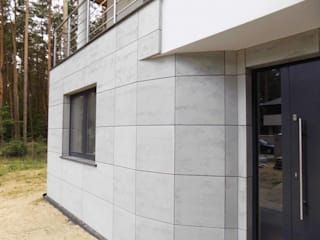 Elewacja budynku - beton architektoniczny Luxum Minimalistyczne domy Beton Szary