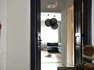 przebudowa domu z lat 30tych Piotr Stolarek Projektowanie Wnętrz Eklektyczny salon