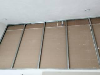 Tablaroca - Muro con asilante acustico e igualado de acabado texturizado. HYPNOS Remodelaciones Residenciales