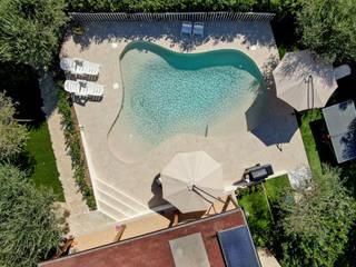 PISCINA NATURA POOL FORMA LIBERA PISCINE TECNOIMP Giardino con piscina Bianco