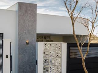 Obra Nueva - Casa Unifamiliar Luciane Gesualdi   arquitectura y diseño Casas unifamilares Hormigón Gris