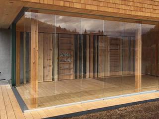 Schmidinger Wintergärten, Fenster & Verglasungen Rustic style balcony, veranda & terrace