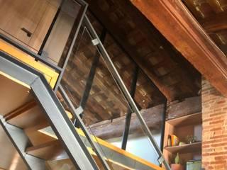 Un altillo sostenible Arquitectura Sostenible e Interiorismo | a-nat Puertas de cristal Tablero DM Acabado en madera