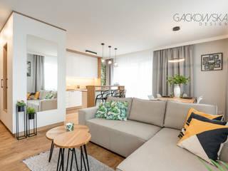 mieszkanie Targówek - projekt i realizacja GACKOWSKA DESIGN GACKOWSKA DESIGN Nowoczesny salon Biały