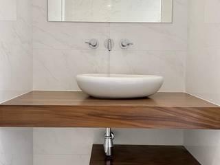 Remodelação T2 Alvalade Buildemant - Construção e Manutenção, Lda Casas de banho modernas