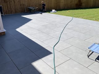 Outdoor Porcelain Paving Installation - Royale Stones Royale Stones Limited Garden Shed