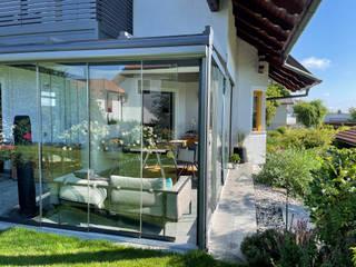 Schmidinger Wintergärten, Fenster & Verglasungen Jardines de invierno de estilo moderno