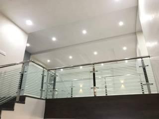 Low Cost Interiors for Duplex villa with 3BHK VeeDesign Studio Asian style corridor, hallway & stairs