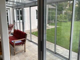 Schmidinger Wintergärten, Fenster & Verglasungen Jardines de invierno de estilo moderno Aluminio/Cinc Gris
