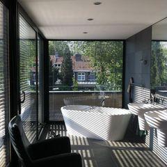 Badkamer als tuinkamer Van de Looi en Jacobs Architecten Moderne badkamers