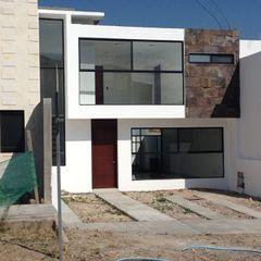 ALVARO CARRILLO arquitecto Casas modernas: Ideas, imágenes y decoración Hormigón Blanco