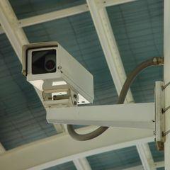 Residential CCTV camera installation first digital surveillance Los Angeles Modern living room Copper/Bronze/Brass Amber/Gold