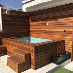 Onice Pisos y Decoracion Modern balcony, veranda & terrace Solid Wood