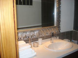 Reforma de baños Tatiana Doria, Diseño de interiores BañosLavabos