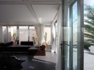 casa t Piano B Architetti Associati Soggiorno in stile asiatico
