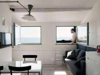 Attico sul Porto gosplan architects Sala da pranzo moderna