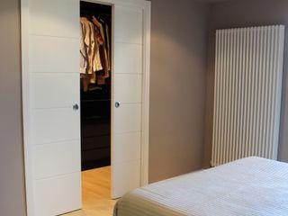 Ernesto Fusco モダンスタイルの寝室 テキスタイル ベージュ