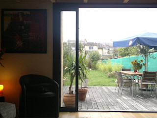 Allegre + Bonandrini architectes DPLG Industrial style balcony, porch & terrace