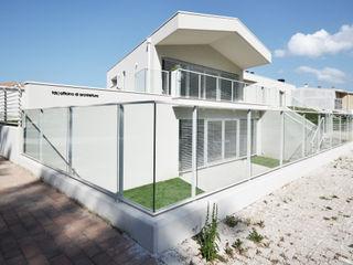 house studio: living workshop francesco valentini architetto Eclectic style houses