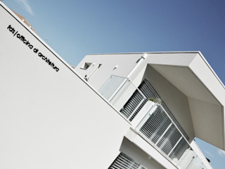 house studio: living workshop francesco valentini architetto Modern houses