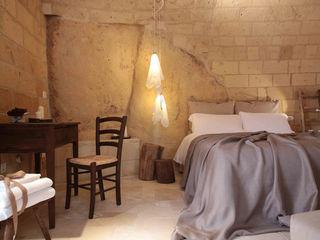 FRANCESCO CARDANO Interior designer Спальня в рустикальном стиле