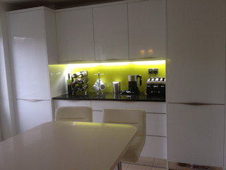 White Gloss Kitchen with Yellow Glass Splashback Henley McKay Kitchens KitchenCabinets & shelves