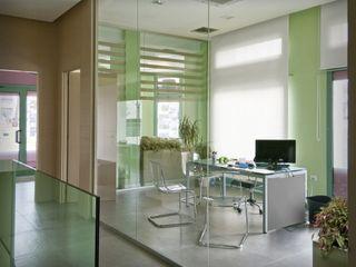 Agenzia immobiliare Albini Architettura Negozi & Locali commerciali moderni