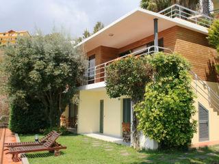 Extension Casa do Papagaio Mayer & Selders Arquitectura Готелі